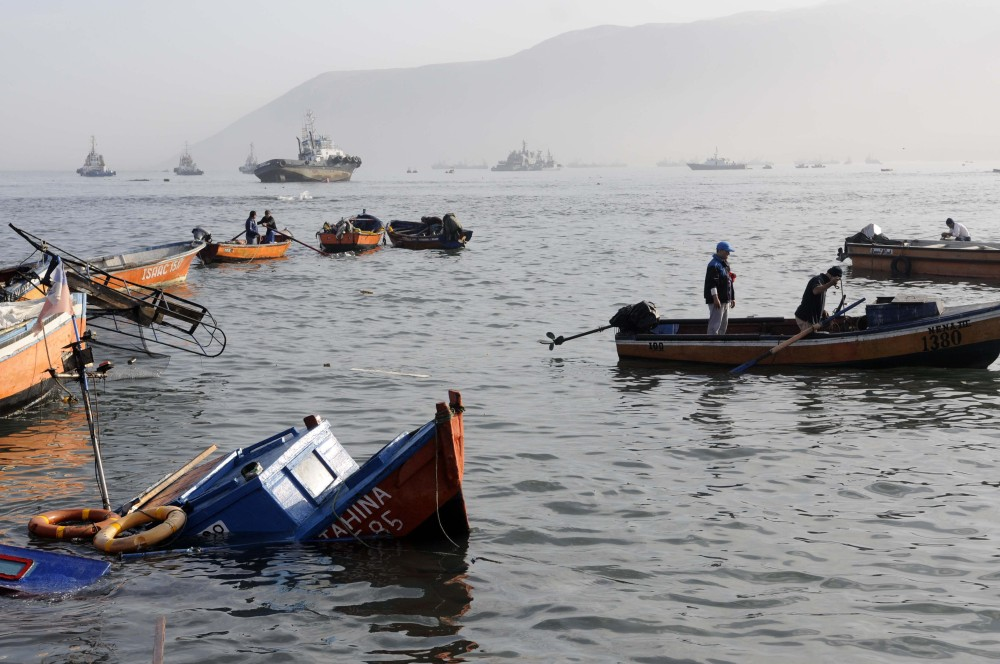 Fishing boats lie damaged in the town of Iquique, Chile, Wednesday after a magnitude-8.2 earthqauke and small tsunami struck the northen coast. Authorities lifted tsunami warnings for Chile's long coastline early Wednesday.