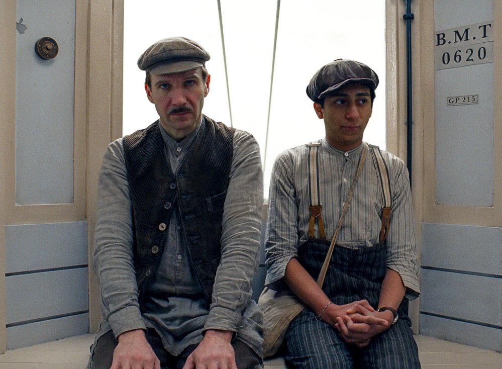 "Ralph Fiennes, left, and Tony Revolori in ""The Grand Budapest Hotel."""