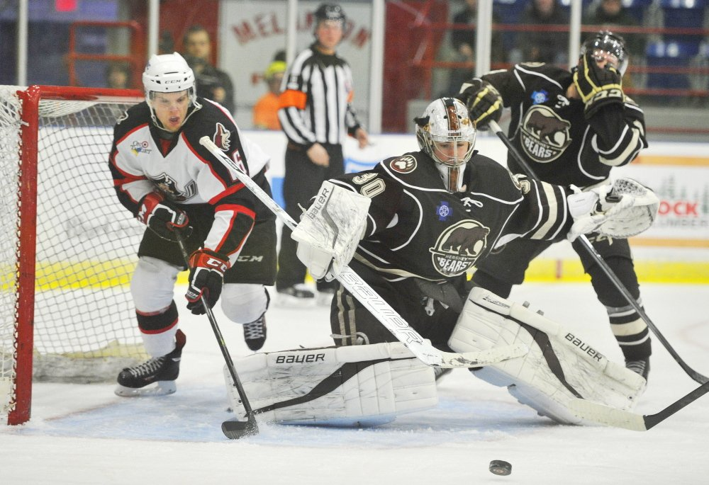 Portland Pirate Brendan Shinnimin tries to reach a rebounded puck from Hershey goalie David Leggio.