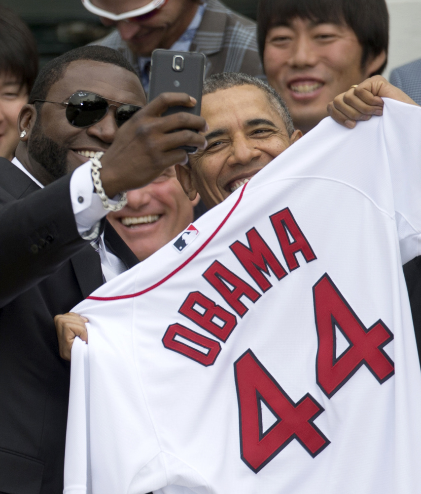 President Obama receives a jersey from David Ortiz, left, of the Boston Red Sox in Washington on Tuesday.