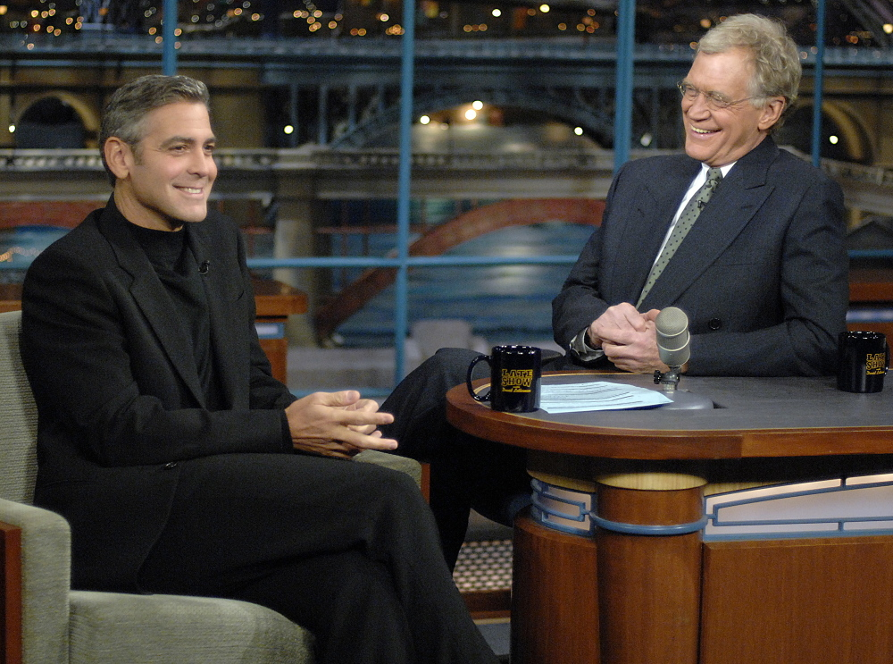 "In this photo released by CBS, George Clooney, left, laughs with host David Letterman on the set of ""The Late Show with David Letterman,"" Tuesday, Nov. 28, 2006."
