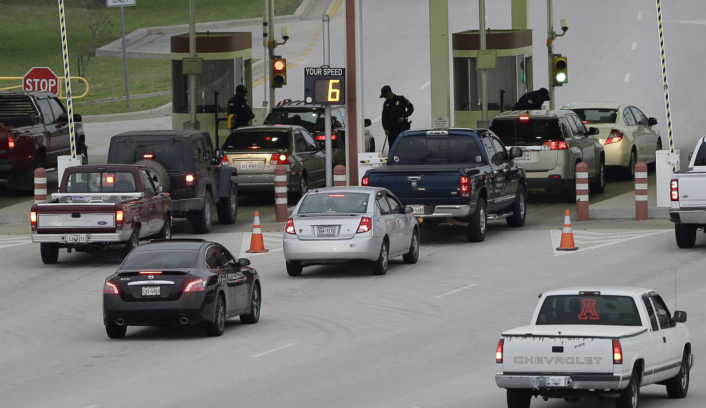 Security check vehicles as they enter Fort Hood's main gate, Thursday, April 3, 2014, in Fort Hood, Texas. A soldier opened fire Wednesday on fellow service members at the Fort Hood military base, killing three people and wounding 16 before committing suicide.
