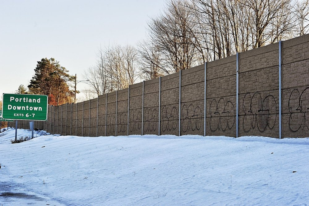 Graffiti covers the sound barrier along Interstate 295 in South Portland.
