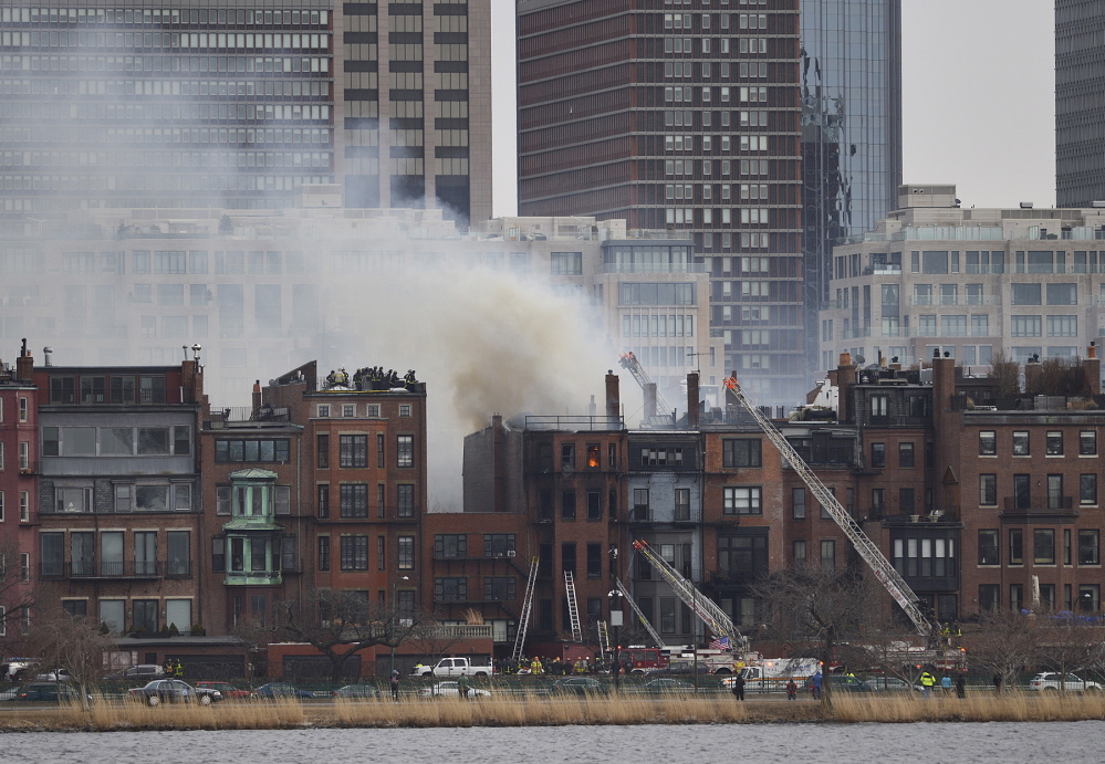 The multi-alarm fire that destroyed a Back Bay brownstone on March 26, 2014. Firefighters Michael Kennedy and Lt. Edward Walsh died when they got trapped in the basement of the building while fighting the blaze.