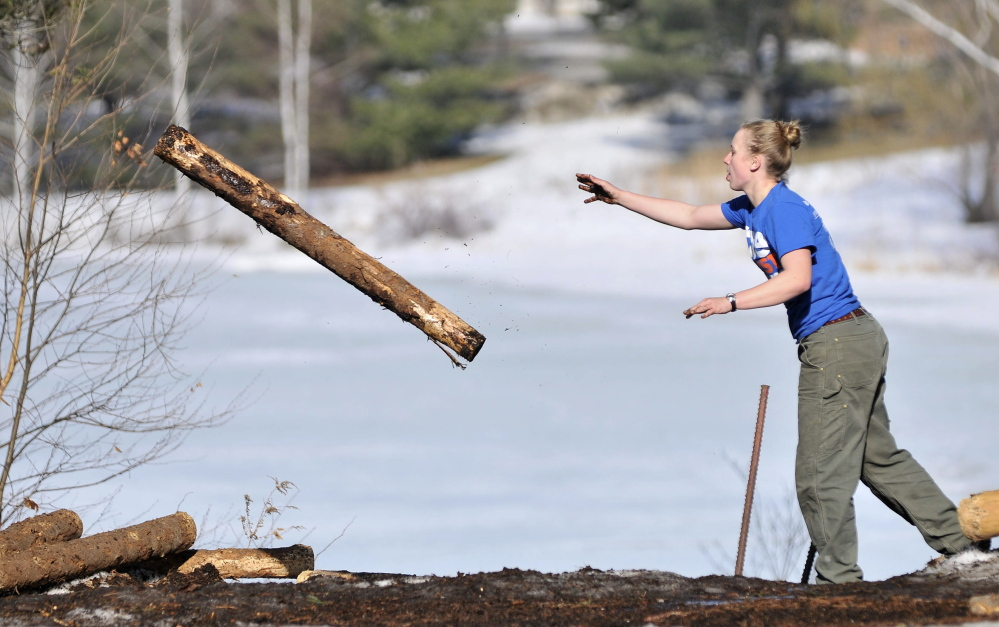 Julia Rogers, a sophomore at Colby College, practices the log toss during on Thursday.