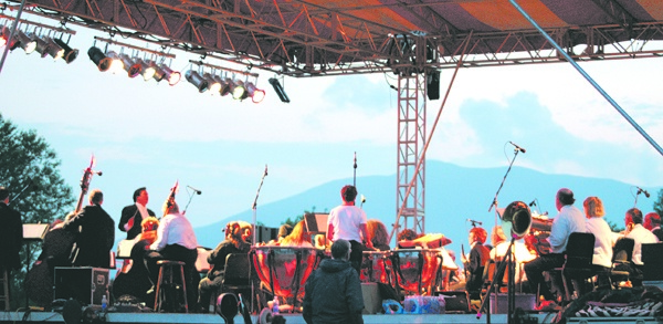 The Bangor Symphony Orchestra plays at the annual Kingfield POPS concert with the western mountains as a backdrop.
