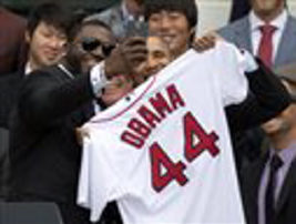"Boston Red Sox player David ""Big Papi"" Ortiz takes a selfie with President Barack Obama on Tuesday, an image that went viral and triggered days of coverage after Samsung said the picture was a publicity stunt for the phone maker."