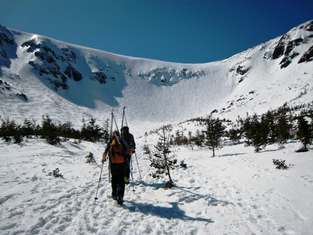 Other ski areas may be closing, but serious downhillers can get in extra runs at New Hampshire's Tuckerman Ravine well into late spring or even early summer, provided they're willing to hike and climb in order to endure some of the most challenging terrain anywhere.