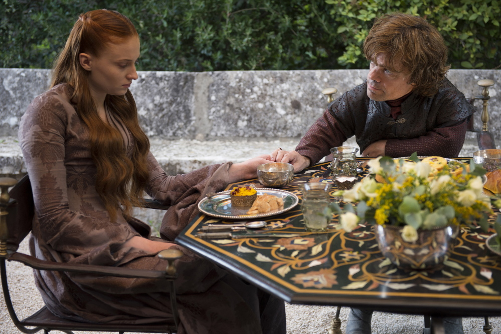 Sophie Turner, left, and Peter Dinklage portray Sansa Stark and Tyrion Lannister.