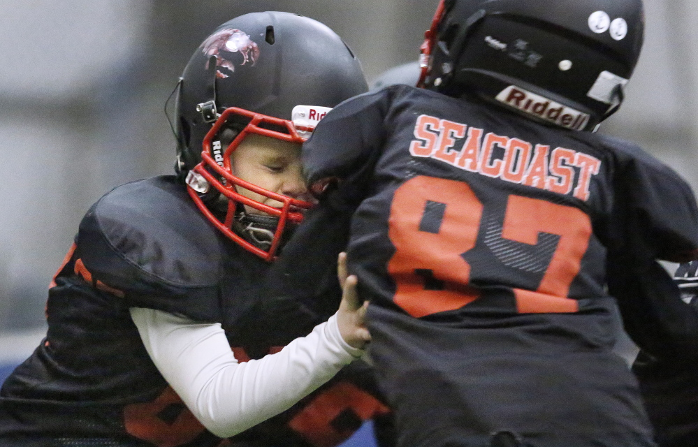William Hersey, left, hits Ryan Chase as the two take part in a full contact drill during a Seacoast Lobsters practice in February at the York Sports Center. The indoor youth football team based in Eliot quickly attracted third- and fourth-graders and their parents when it formed this winter.