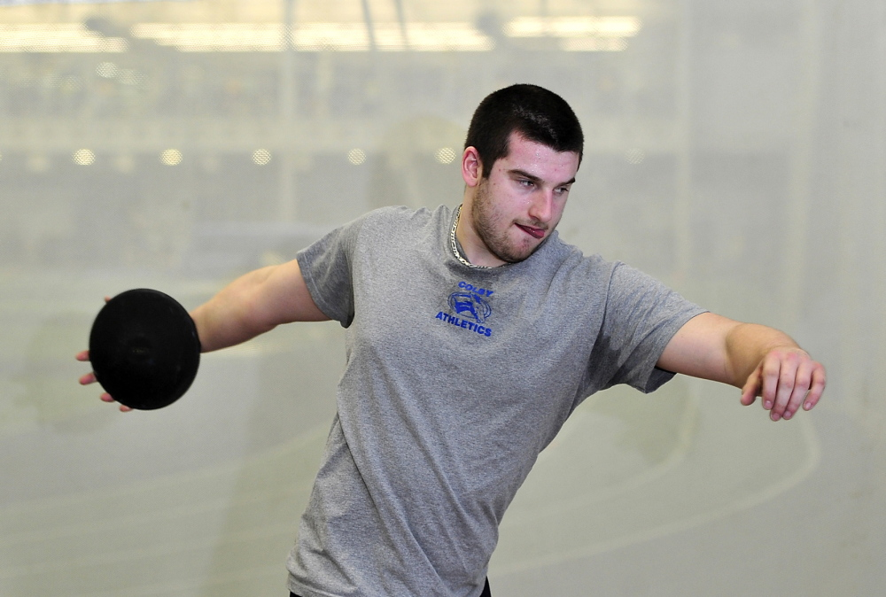 """Billy Parker works on his discus-throwing form at Alfond Athletic Center at Colby College last month. Parker, who started playing football as a third-grader in Massachusetts, suffered a concussion during a football practice at Colby last fall and says, """"I'm not 100 percent of the way to where I was before the injury."""""""