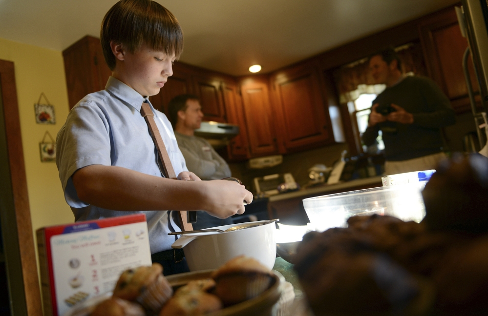 David Albright, an eighth-grader at St. Mary's School, bakes muffins at his home in Milford, Conn. He started making muffins for the homeless when he was 8 years old. He delivered this batch to the Beth El shelter in Milford.