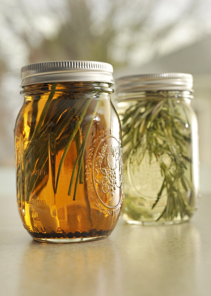 Jars of rosemary and garlic-chive peppercorn vinegar