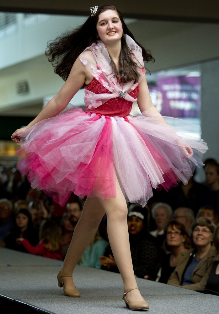 Lauren Tudor, a student at Portland Arts & Technology High School, walks down the runway in the school's Collection 2014 fashion show at the Maine Mall on Saturday.