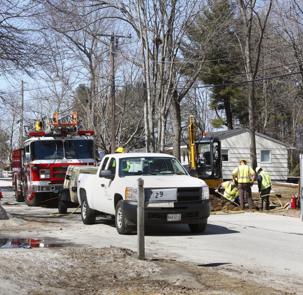 Workers replace a valve on a gas line after a leak on Abby Road in North Windham on Sunday. Four residences were evacuated Sunday morning.