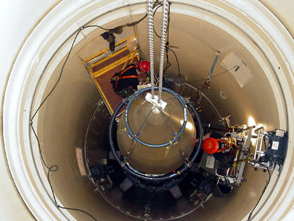 In this image released by the U.S. Air Force, an Air Force Base missile maintenance team removes the upper section of an ICBM at a Montana missile site. The U.S. will keep its current force of 450 land-based nuclear missiles but remove 50 from their launch silos as part of a plan to bring the U.S. into compliance with a 2011 U.S.-Russia arms control treaty.