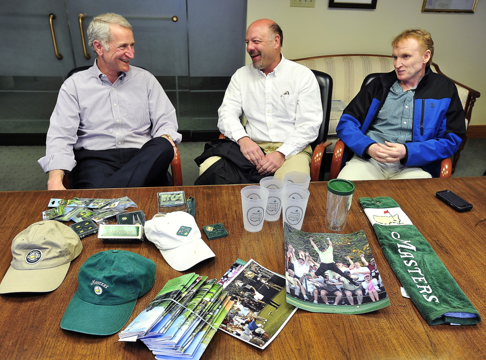 Local golf enthusiasts, from left, David Ray, David Chipman and Scott Brown, talk about their experiences going to the Masters behind a collection of memorabilia owned by Ray.
