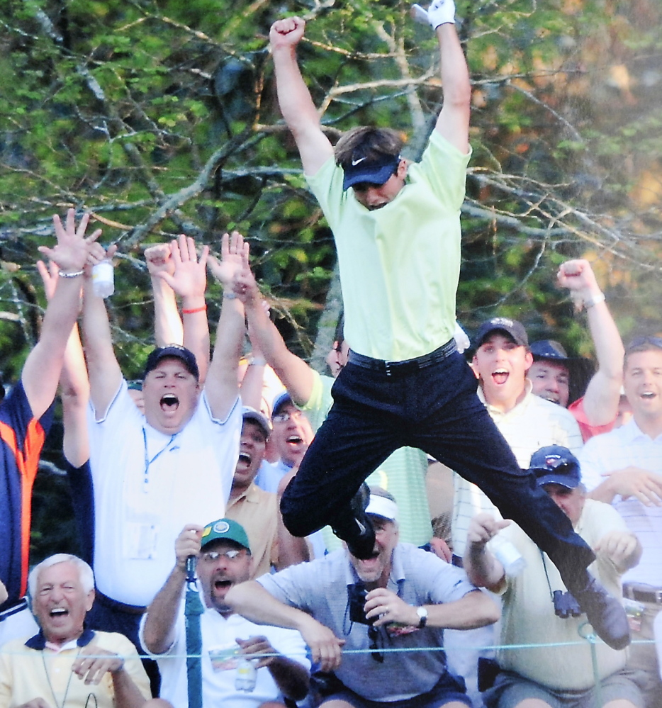 Think Trevor Immelman was happy, hitting a hole-in-one on the 16th at the Masters in 2005? Check out two fans from Maine. That's David Chipman of Brunswick, second left, and David Ray of Yarmouth, behind Immelman's shoe.