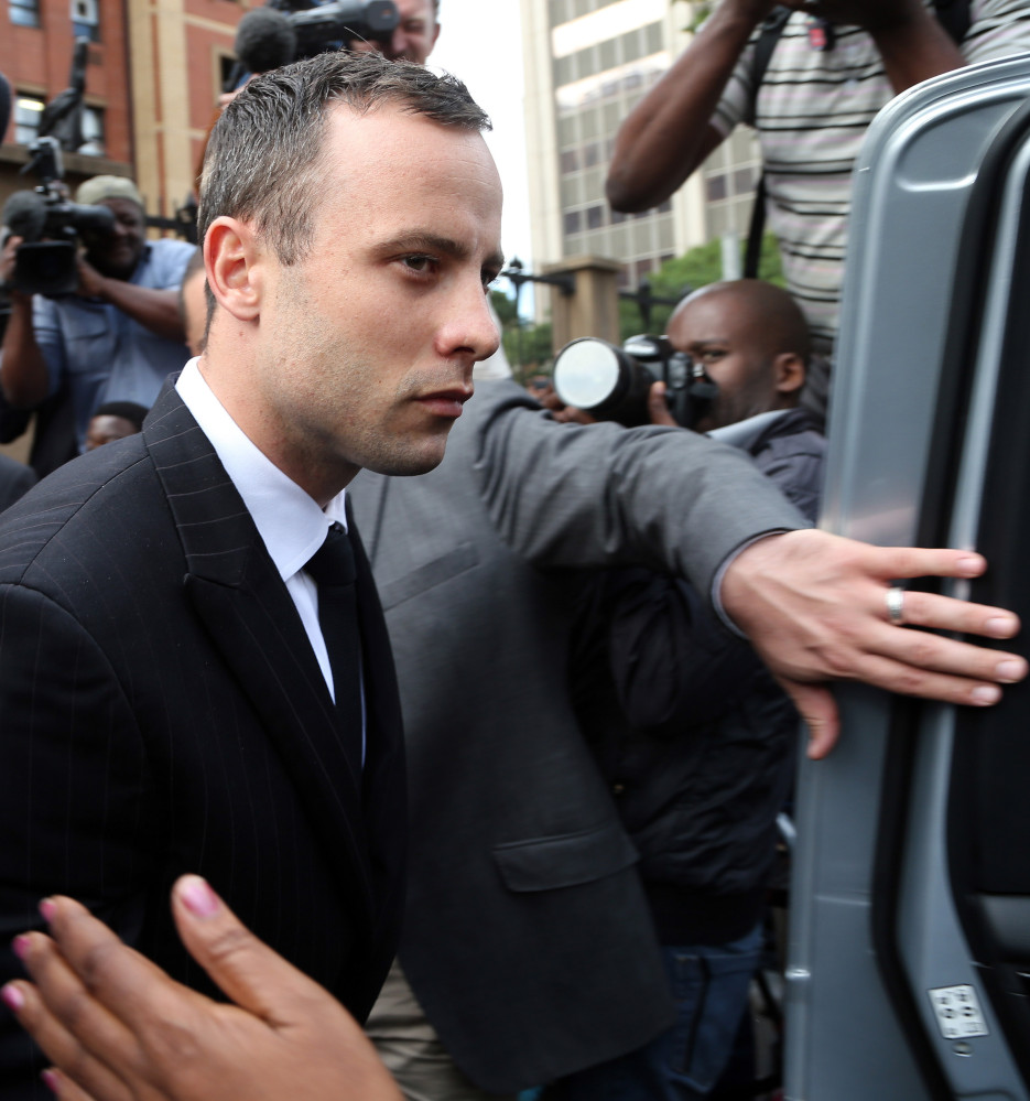 Oscar Pistorius leaves the high court in Pretoria, South Africa, Wednesday. He faces a possible prison term of 25 years to life if convicted of premeditated murder.