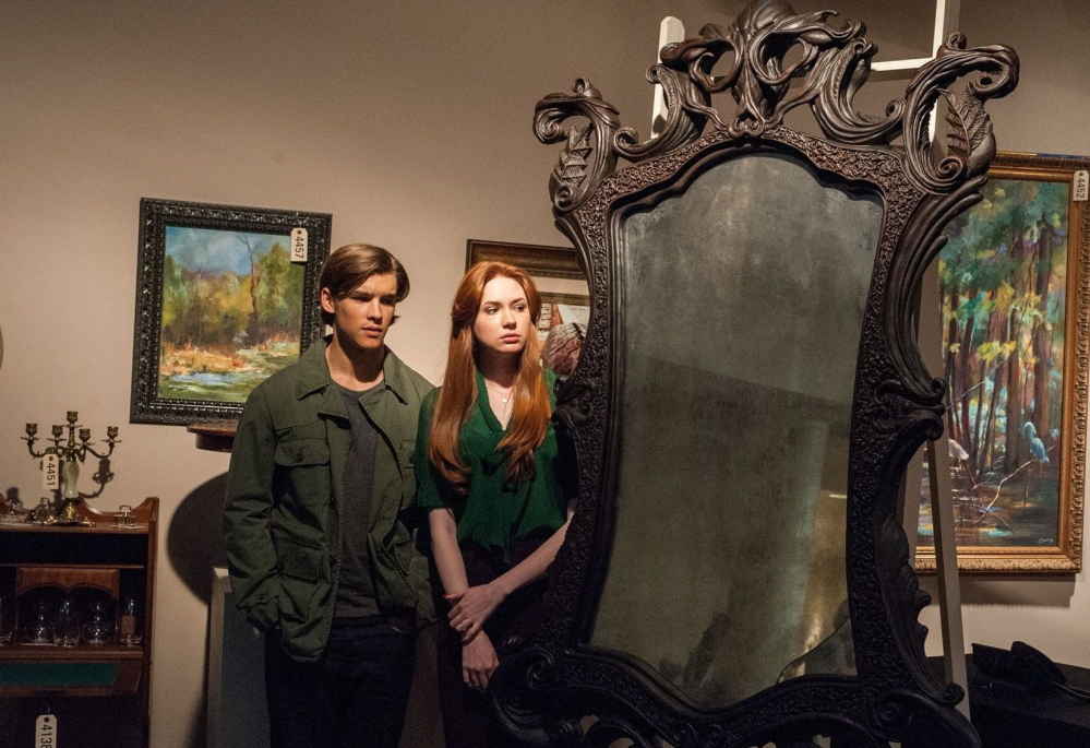 "Brenton Thwaites as Tim Russell and Karen Gillan as Kaylie Russell with the mysterious mirror in ""Oculus."""