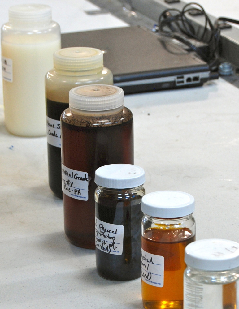Samples of different formulas of glycerol and diesel fuel are shown at the SeaChange lab in Bucksport.