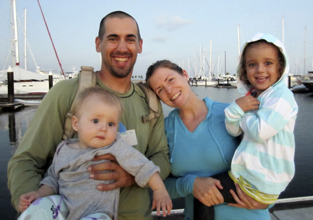 Eric and Charlotte Kaufman hold their daughters Lyra, 1, and Cora, 3. Four California Air National Guard members parachuted to the sailboat April 3 and stabilized Lyra with medication for salmonella-like symptoms.