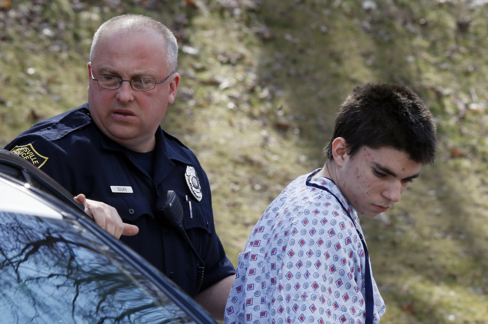 Alex Hribal, 16, the suspect in the multiple stabbings at the Franklin Regional High School in Murrysville, Pa., is escorted by police to his arraignment on Wednesday.