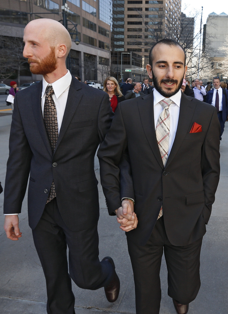 Moudi Sbeity, right, and his partner Derek Kitchen leave the courthouse following a hearing at the U.S. Circuit Court of Appeals in Denver.