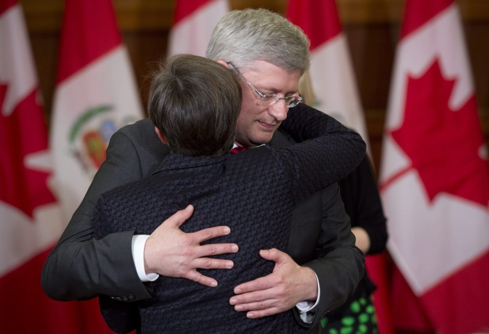 "Canadian Prime Minister Stephen Harper embraces MP Kellie Leitch after announcing that former Finance Minister Jim Flaherty had died Thursday in Ottawa. Harper called the death of the long-serving minister ""an unexpected and a terrible shock."""