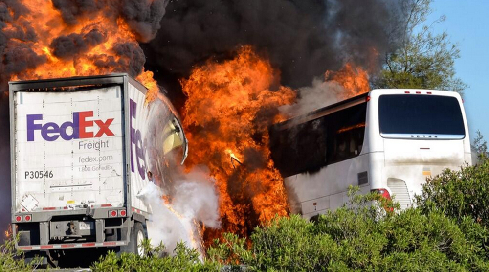 Flames enveloped a tractor-trailer and a tour bus just after the crash Thursday until firefighters were able to extinguish the fire, leaving behind scorched black hulks of metal.