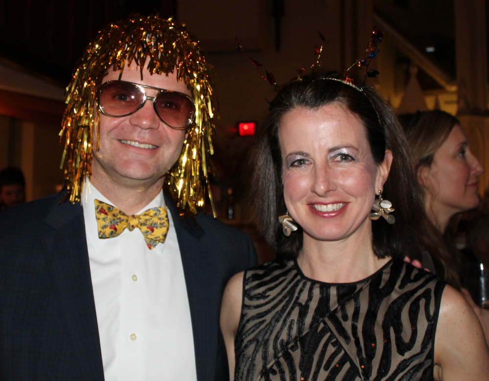 Geoff Wagg, head of school at Waynflete, gets into the spirit of the evening with his wife, Alice.