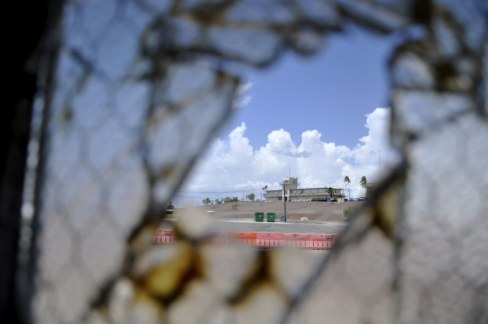 One of Guantanamo Bay's two courthouses is seen through a broken window at Camp Justice at the U.S. naval base in Cuba. On Monday, a judge in Guantanamo will open a hearing into the sanity of prisoner Ramzi Binalshibh, whose courtroom outbursts about alleged mistreatment in Camp 7 at the base have halted the effort to try five men in the Sept. 11 attacks, all of whom are held there.