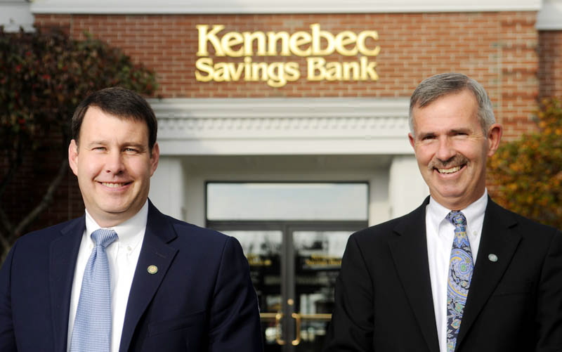 For the future: Kennebec Savings Bank Executive Vice President Andrew Silsby, left, and President Mark Johnston outside the bank in a file photo from October 2013. They say the bank is converting to a new organizational structure to help it remain a mutual savings bank in the future.