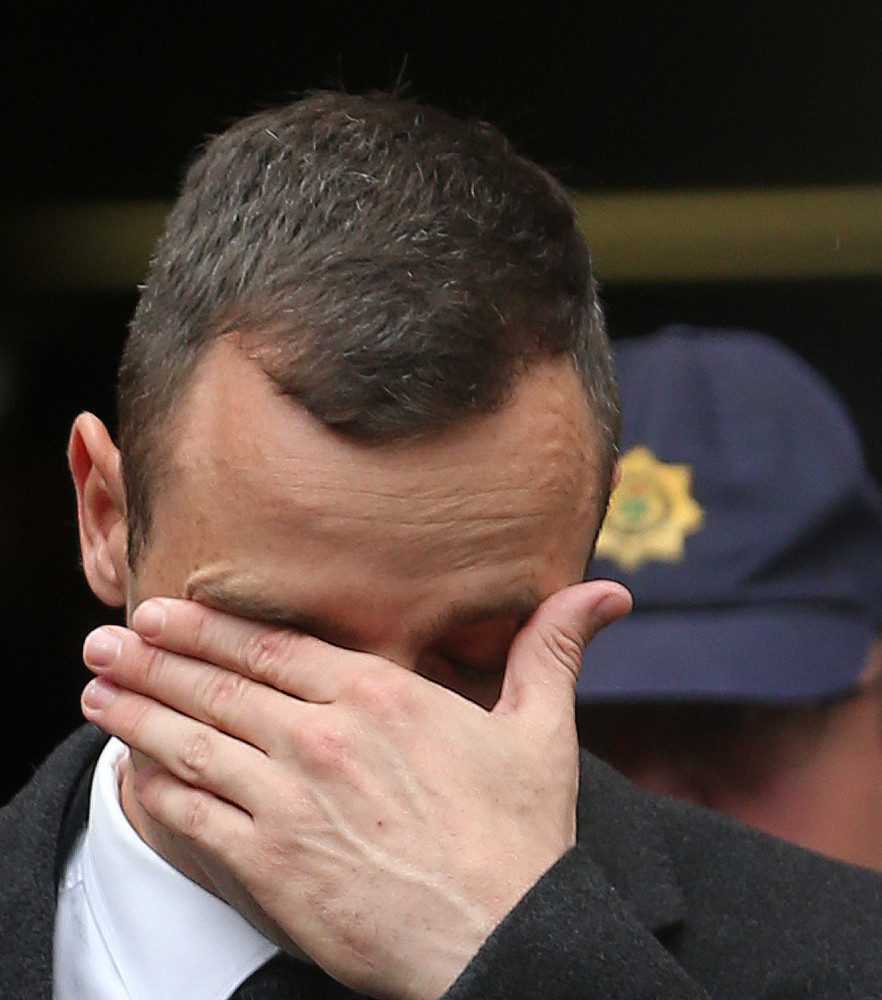 Oscar Pistorius, leaves the high court in Pretoria, South Africa, Monday. He is charged with murder in the shooting death of his girlfriend.