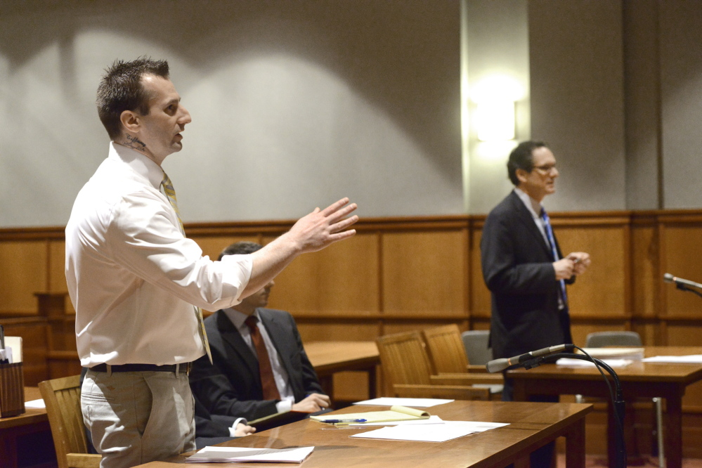 Joshua Nisbet addresses Justice Thomas Warren in Cumberland County Unified Criminal Court during the judge's instructions prior to jury selection. Assistant District Attorney Bud Ellis is in the background.