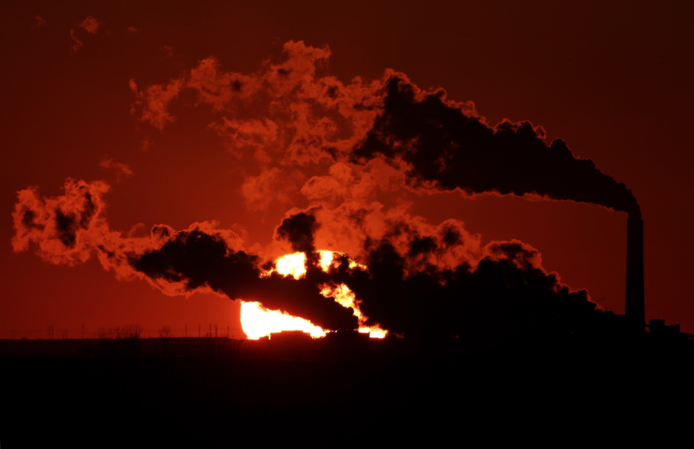 Steam from the Jeffrey Energy Center coal-fired power plant is silhouetted against the setting sun as the facility generates power last month near St. Marys, Kan. A federal appeals court Tuesday upheld the Environmental Protection Agency's emission standards for a variety of pollutants.