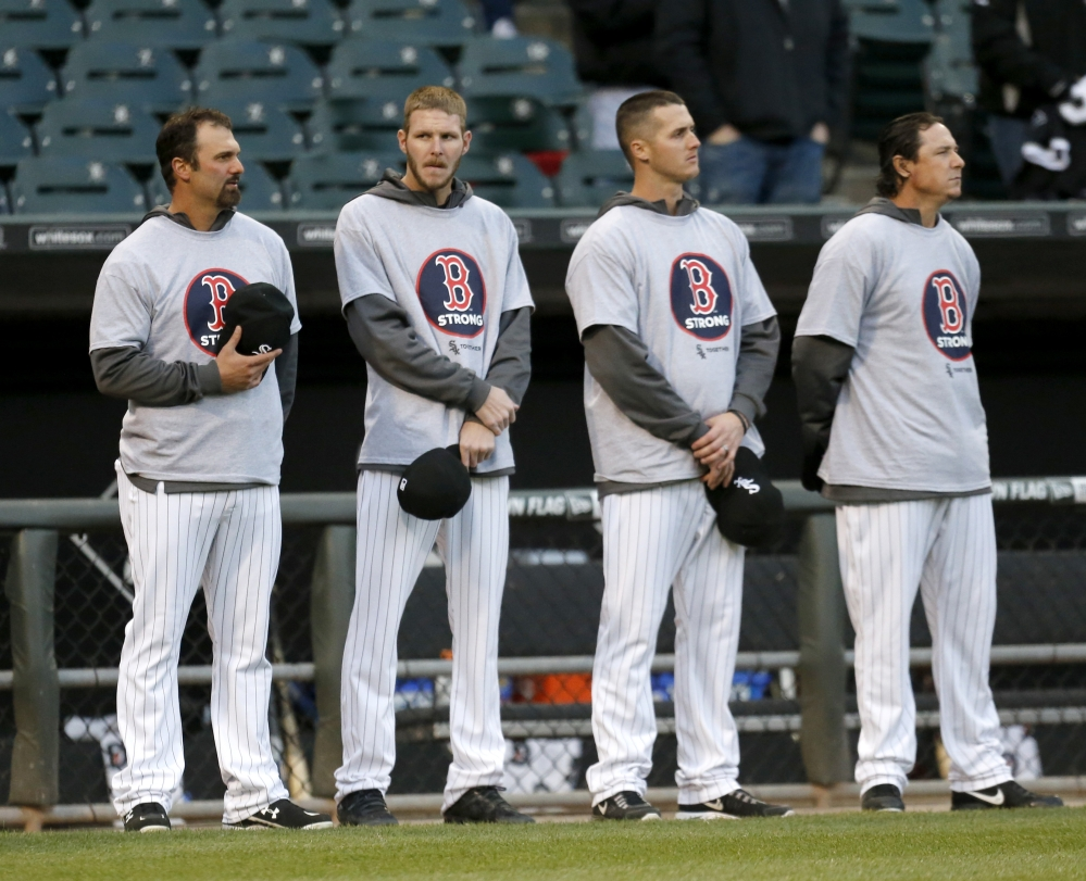 Members of the Chicago White Sox, from left, Paul Konerko, Chris Sale, Nate Jones, and Scott Downs stand wearing Boston Strong shirts before the game against Boston on Tuesday.