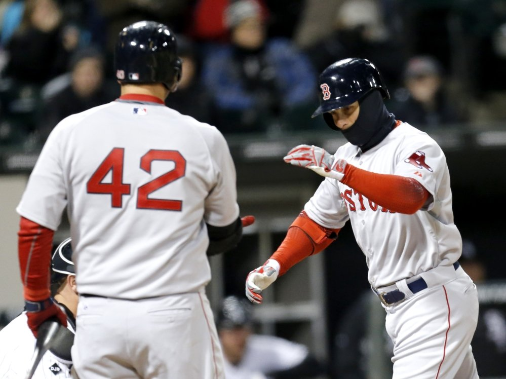 Boston's Daniel Nava, right, is greeted at home by A.J. Pierzynski after Nava hit a fourth-inning home run off Chicago White Sox starting pitcher Erik Johnson.