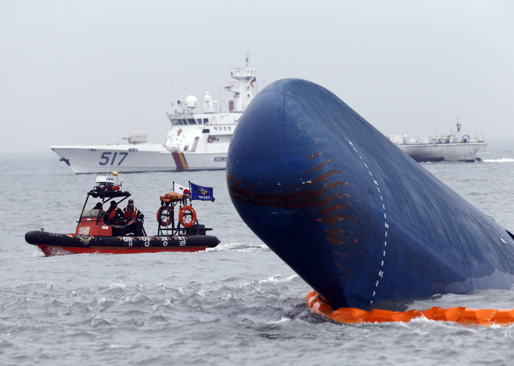 Boats sail around the South Korean passenger ship Sewol during their rescue operation in the sea off Jindo on Thursday, after the ferry capsized in sight of land.