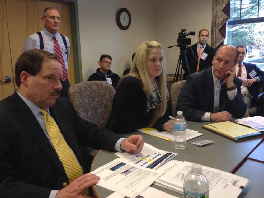From left, Cate Street Capital officials Dammon Frecker and Alexandra Ritchie, and its attorney Christopher Howard attend the FAME board meeting in Augusta on Thursday.