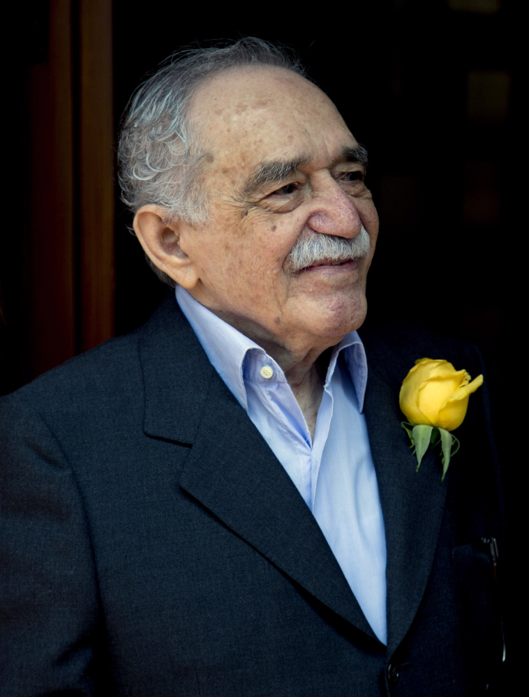 In this March 6, 2014 file photo, Colombian Nobel Literature laureate Gabriel Garcia Marquez greets fans and reporters outside his home on his 87th birthday in Mexico City. Marquez died Thursday April 17, 2014 at his home in Mexico City.