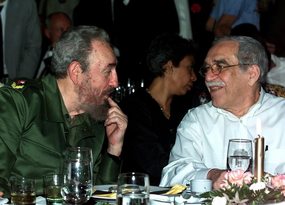 Cuba's leader Fidel Castro, left, and Colombian Nobel laureate Gabriel Garcia Marquez speak during a dinner at the annual cigar festival in Havana, Cuba.