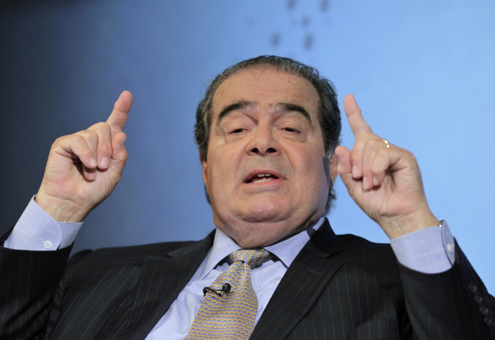 U.S. Supreme Court Justice Antonin Scalia, shown in 2012, remains opposed to the landmark New York Times v. Sullivan decision 50 years later.