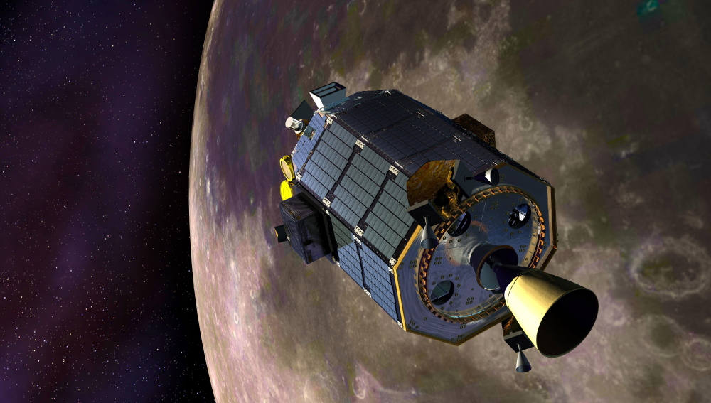In this artist's concept provided by NASA the Lunar Atmosphere and Dust Environment Explorer – LADEE – spacecraft is seen orbiting the moon .