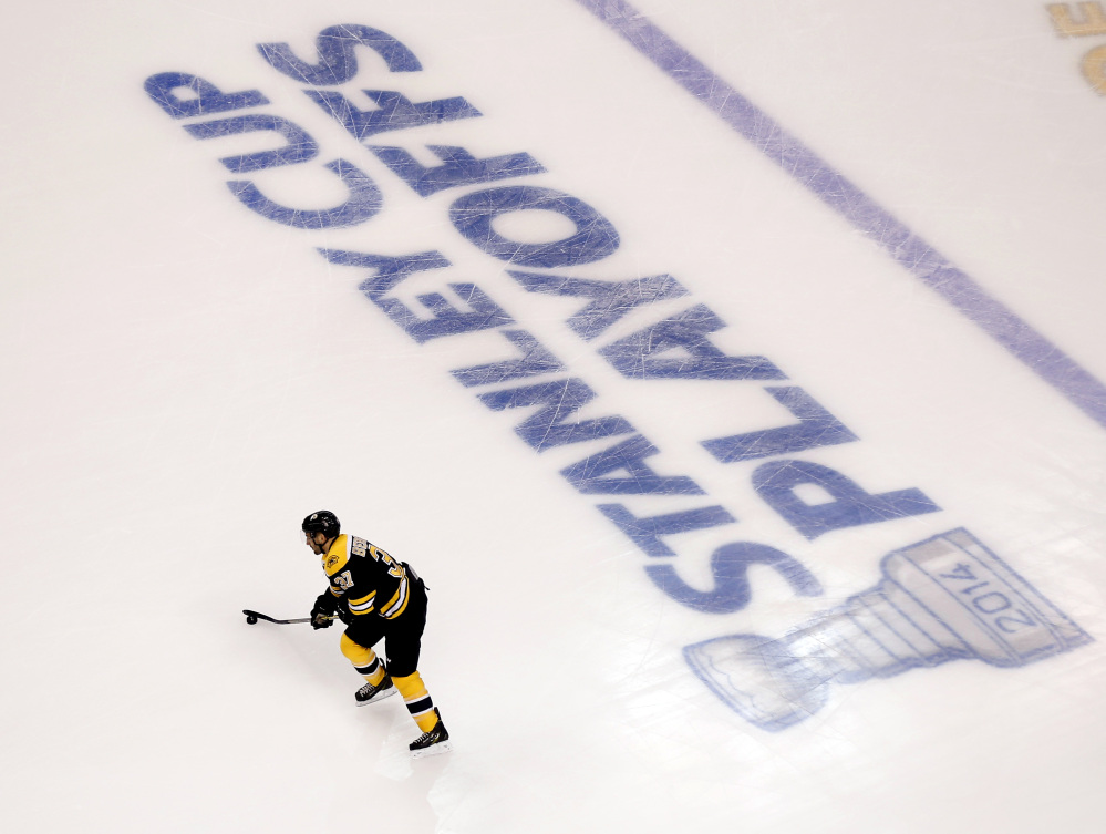Boston Bruins' Patrice Bergeron warms up for Game 1 of a first-round NHL playoff hockey series against the Detroit Red Wings in Boston on Friday, April 18, 2014.