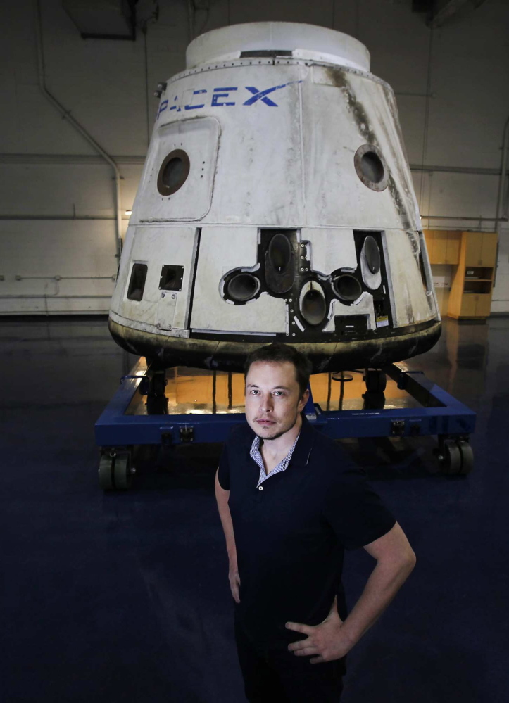 "Elon Musk poses with the SpaceX Dragon capsule in Hawthorne, Calif., in 2012. ""I have no doubt that he will get man to Mars in his lifetime,"" said his dad, Errol Musk."