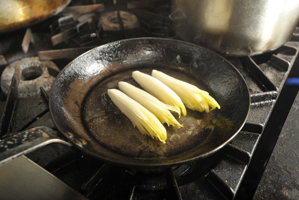 The endive is sautéed on the stove top, then finished in the oven.