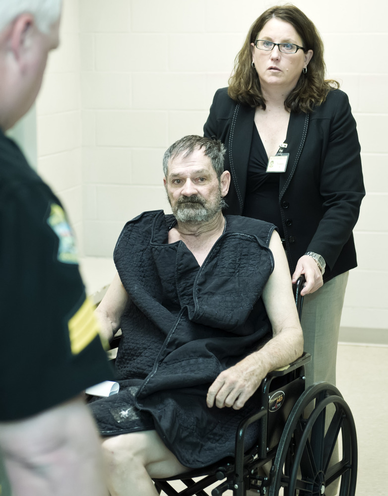 Frazier Glenn Cross, also known as F. Glenn Miller, appears at his arraignment in New Century, Kan., last Tuesday. Cross is charged with shootings that left three people dead at two Jewish community sites in suburban Kansas City on April 13. At upper right is Michelle Durrett, attorney with the public defender's office.