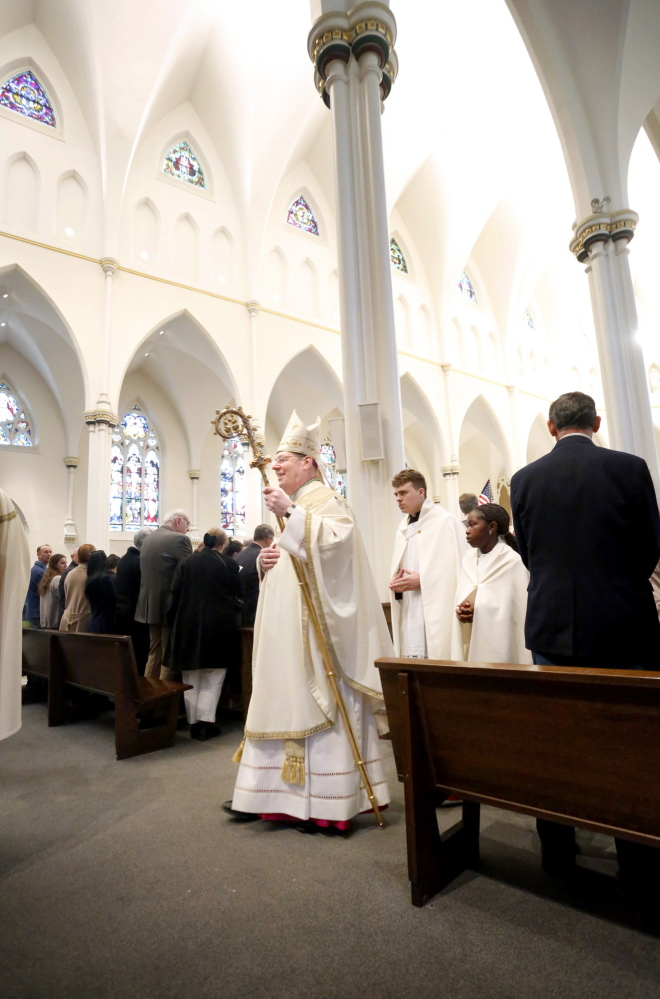 Most Rev. Robert P. Deeley, bishop of the Roman Catholic Diocese of Portland, walks in the procession during Easter Mass at the Cathedral of the Immaculate Conception in Portland on Sunday morning.