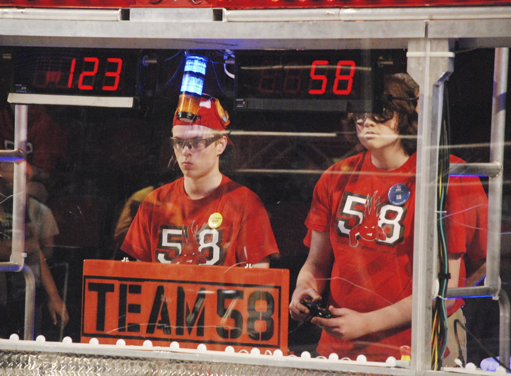 Ross Usinger, left, and Alexander Manning compete for the Riot Crew robotics team from South Portland.